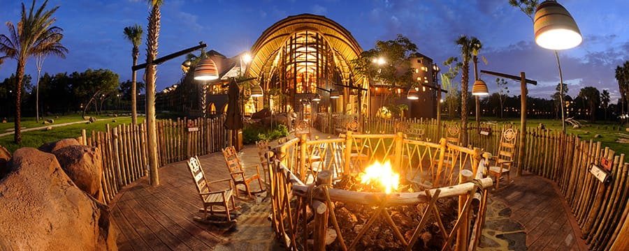 Wooden rocking chairs surrounding a firepit at Disney's Animal Kingdom Lodge
