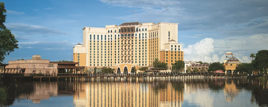 The multistory Disney's Coronado Springs Resort hotel situated on the shores of Lago Dorago