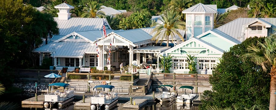 4 boats docked in the waters near the gabled exterior of Disney's Old Key West Resort