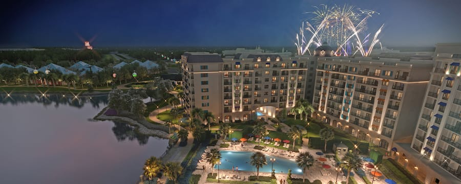 Fireworks bursting in the sky above Disney's Riviera Resort at night