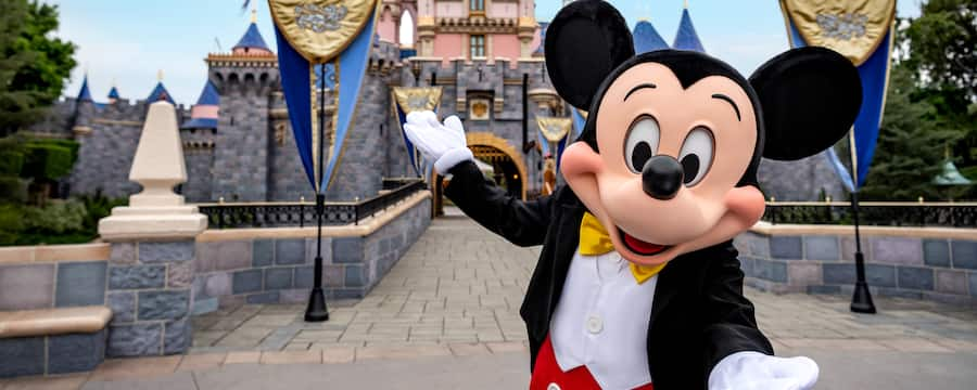 Mickey, in front of the bridge leading to Sleeping Beauty Castle, welcomes you to Disneyland Park