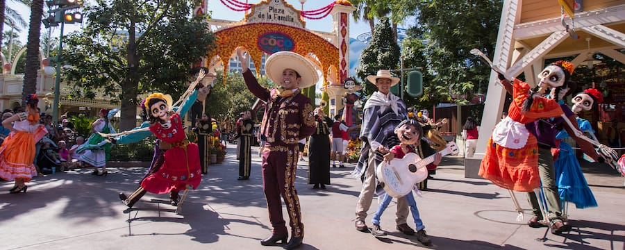 Colorfully costumed performers dance at Plaza de la Familia