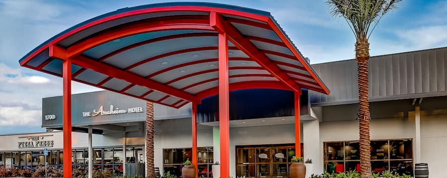 A large, rounded awning stretches out from above the lobby doors of the Anaheim Hotel