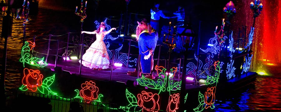 The beauty, Belle, and the Beast dance on a romantic, rose-decorated Fantasmic! float