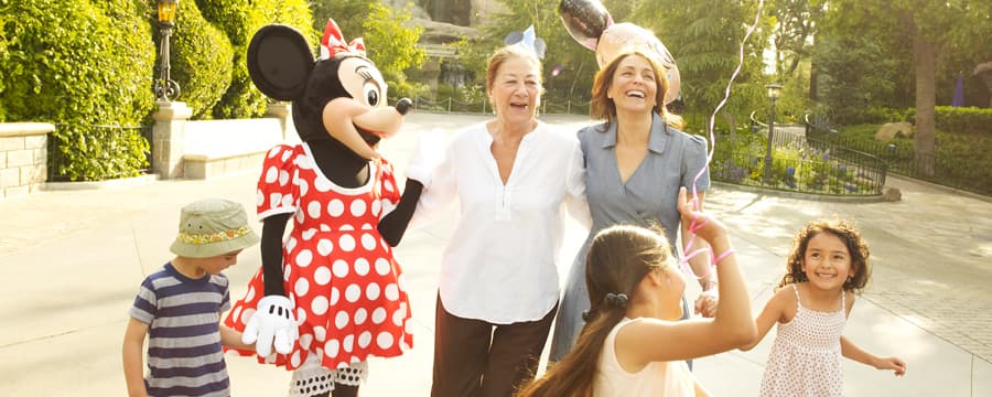Mickey Mouse and a little girl share a laugh during the girl'€™s birthday party at Disneyland Park