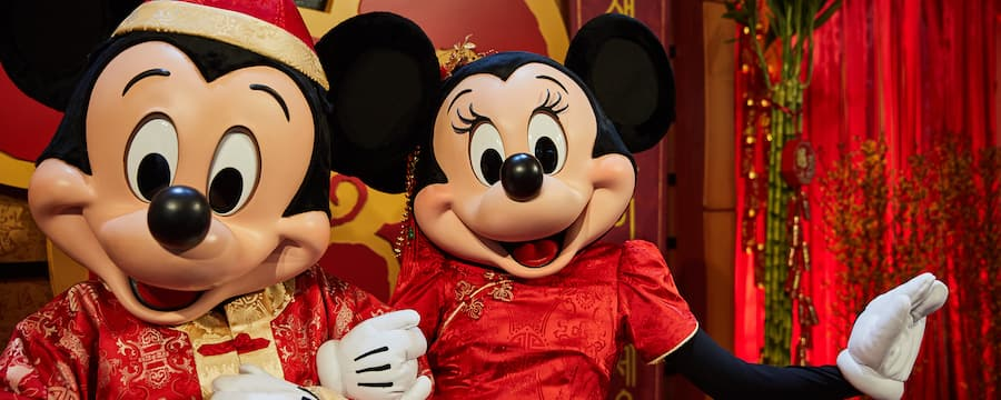 Mickey and Minnie dressed in festive costumes at Disneyland lunar new year