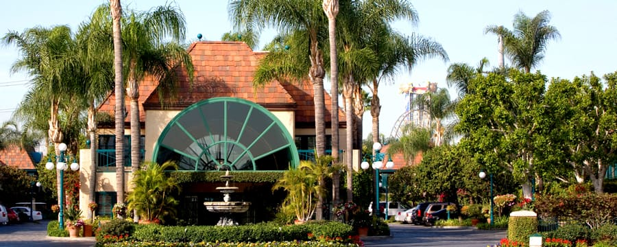 The main entrance to the classically-styled Candy Cane Inn featuring a fountain and palm trees