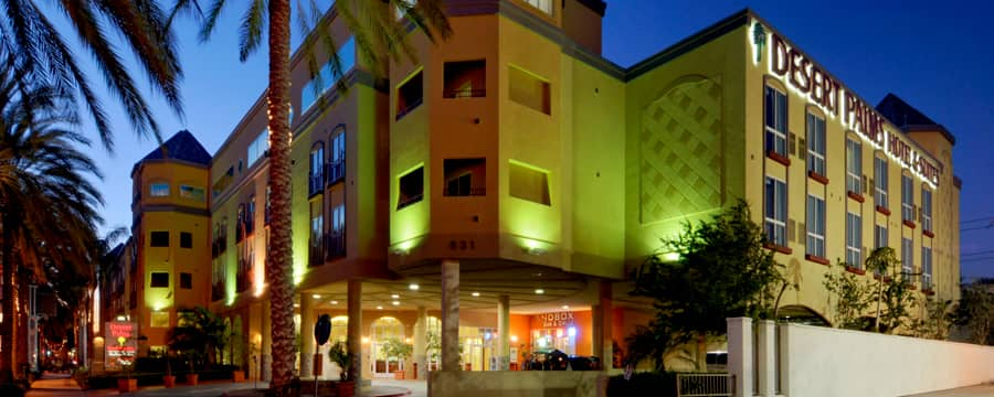 The front entrance to the Desert Palms Hotel & Suites lit up at night