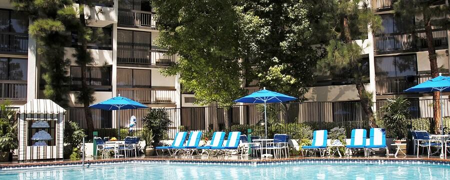 Outdoor furniture around the Garden Pool at Howard Johnson Anaheim Hotel & Water Playground