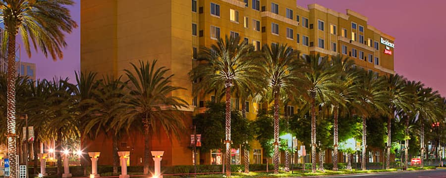 Large palm trees line the perimeter around the Residence Inn Anaheim Resort Area