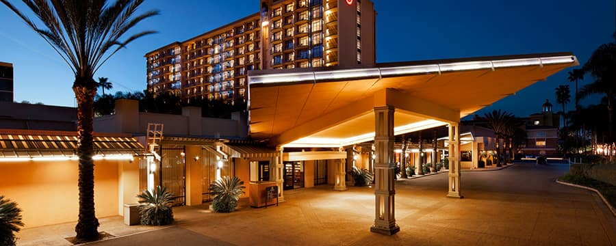 The modern carport and entrance to the Sheraton Park Hotel at the Anaheim Resort lit up at night
