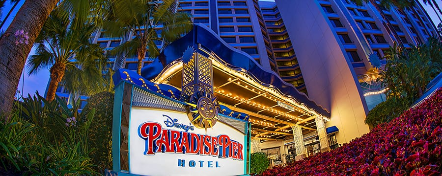 Tall palm trees in front of Disney's Paradise Pier Hotel topped with a distinct wave design