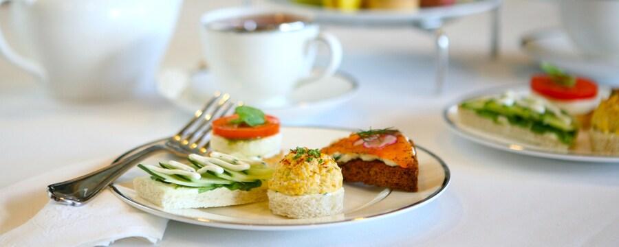 An assortment of plated tea sandwiches