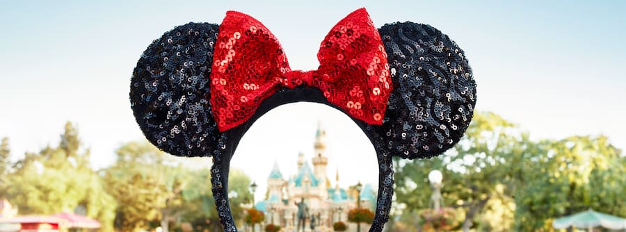 Cinderella Castle is visible inside the headband of a pair of Minnie Ears, as if it is being framed