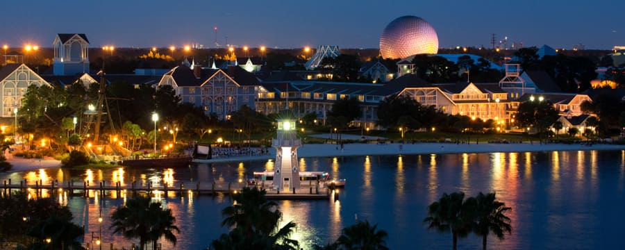 A nighttime view of Disney's Beach Club Resort from Crescent Lake