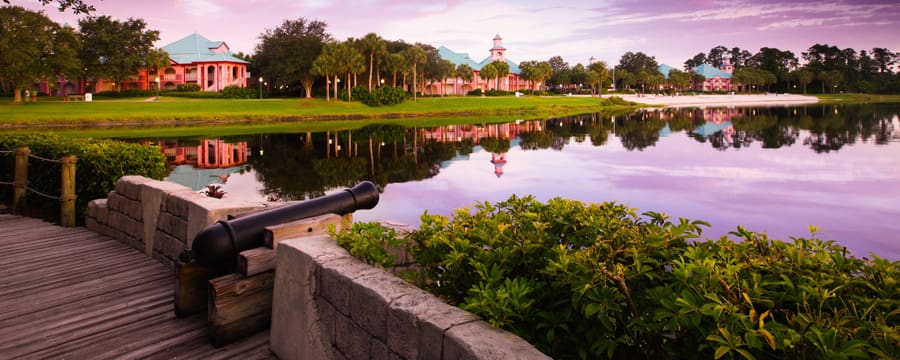 Disney's Caribbean Beach Resort seen across Barefoot Bay at sunset