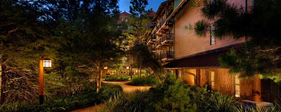 The tree-lined walkway at The Villas at Disney's Wilderness Lodge, lit up at night
