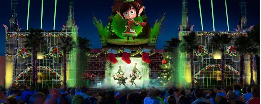 Un spectacle de lumière présentant des personnages du film de Disney Prep and Landing projeté à l'extérieur du Chinese Theater à Disney's Hollywood Studios