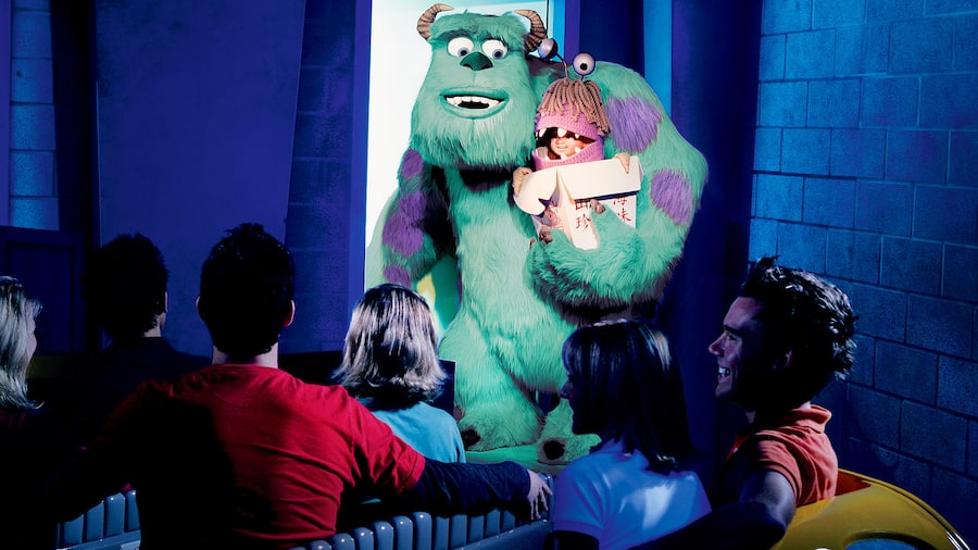 A group of people look at Sully holding Boo
