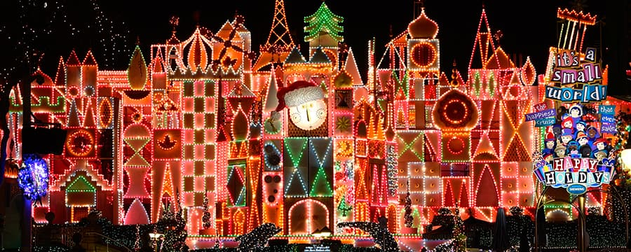 the its a small world attraction decorated with christmas lights