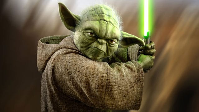 Yoda poses with a light saber