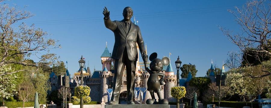 A statue of Walt Disney and Mickey Mouse