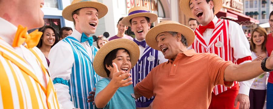 A father and son sing along with the Dapper Dans while on their Disney vacation at Disneyland Resort