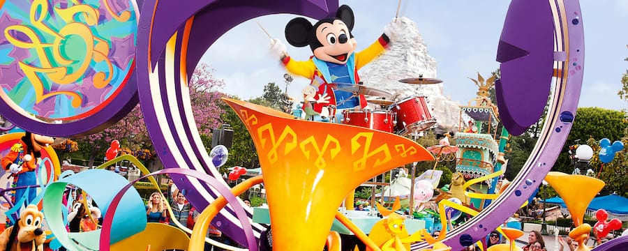 A parade featuring Mickey Mouse, Pluto, Goofy and other Disney Characters
