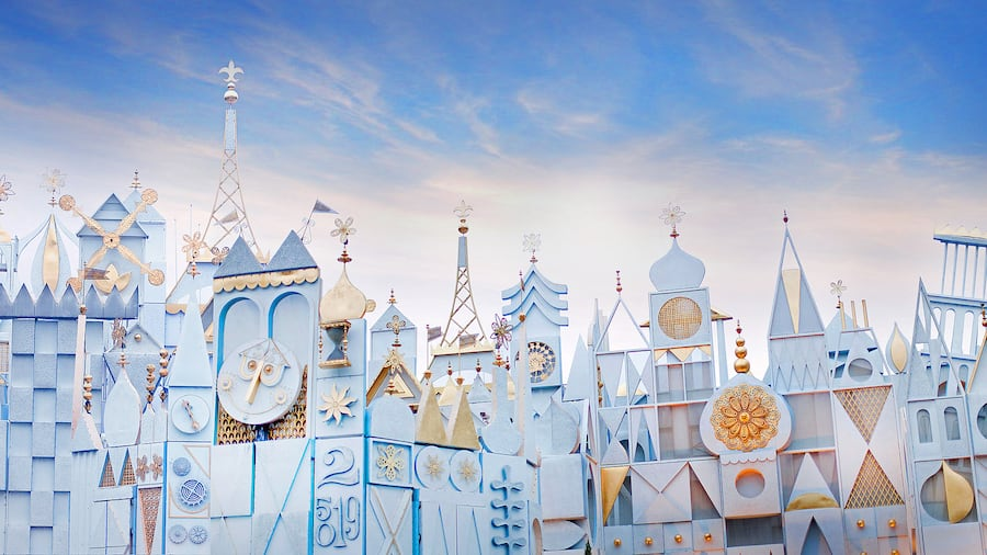 The its a small world attraction with whimsical designs including fantastical turrets and rooftops