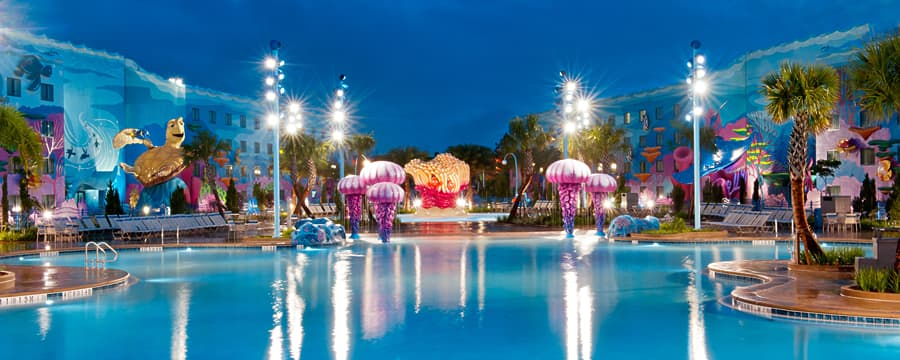 The pool area at night at Disney's Art of Animation Resort