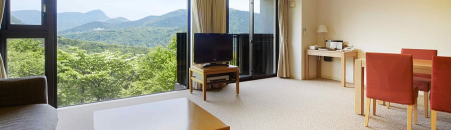 The living area and dining area of a suite at Tokyu Vacations Hakone Gora Resort