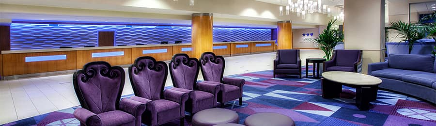 The lobby sitting area and reception desk at Disneyland Hotel in California