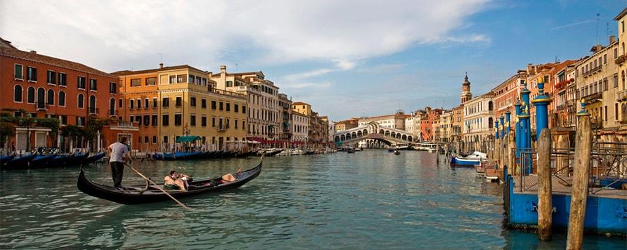 A gondola cruising along a canal in Venice, Italy