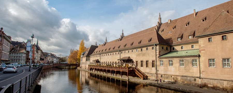 Buildings and a roadway surrounding the Rhine River in Strasbourg, France