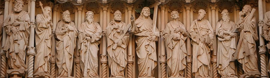 Statues of Jesus and his disciples on the exterior of the building