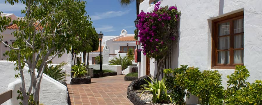 A tiled walkway between buildings at Silverpoint Beverly Hills Club in Tenerife