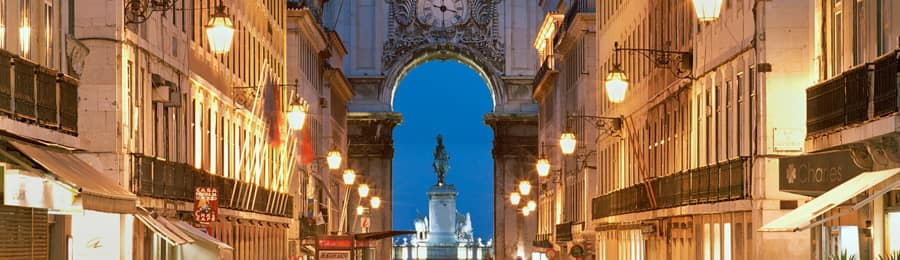 A dramatic archway over a street in Europe