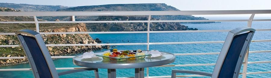 A balcony overlooking the Mediterranean Sea at Radisson Blu Resort & Spa, Malta Golden Sands