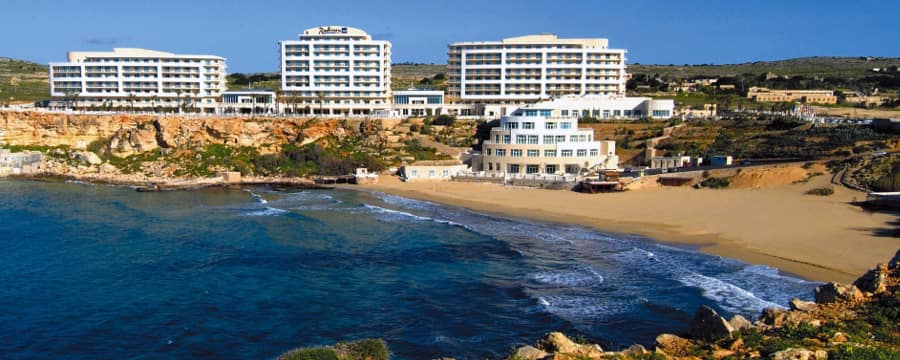 The beach and Mediterranean Sea by Radisson Blu Resort & Spa, Malta Golden Sands