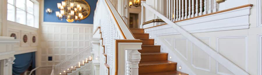 A grand staircase at Disney's Newport Bay Club in Paris