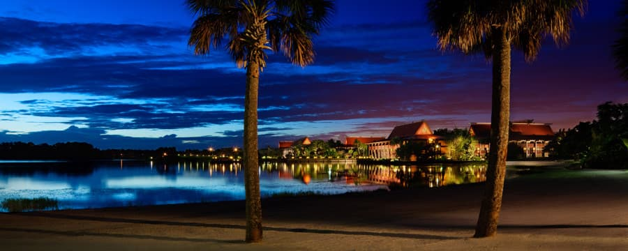 Disney's Polynesian Village Resort and Seven Seas Lagoon at night