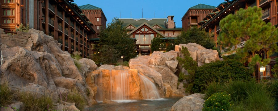 The building exterior and waterfall at Disney's Wilderness Lodge in Florida