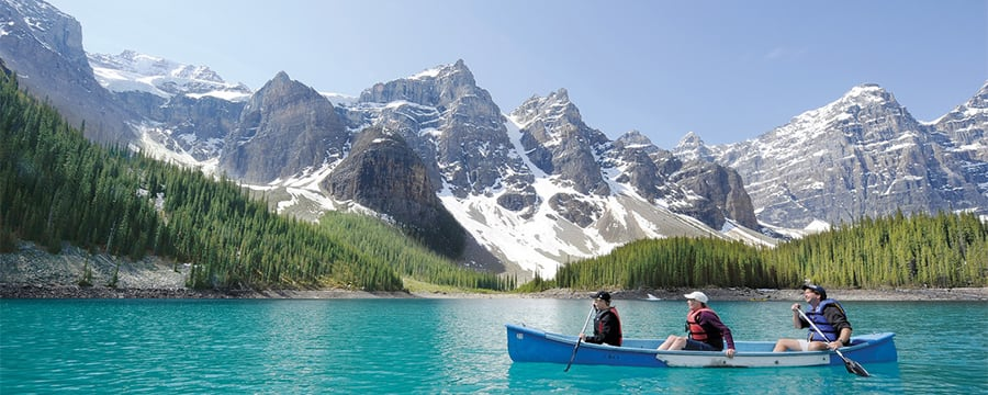 People canoeing on a serene lake