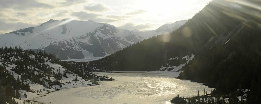 An icy lake surrounded by snowcapped mountains