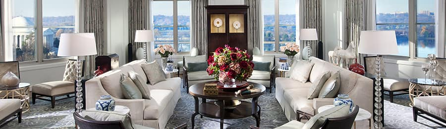 A living area with windows overlooking the Thomas Jefferson Memorial in Washington, D.C.