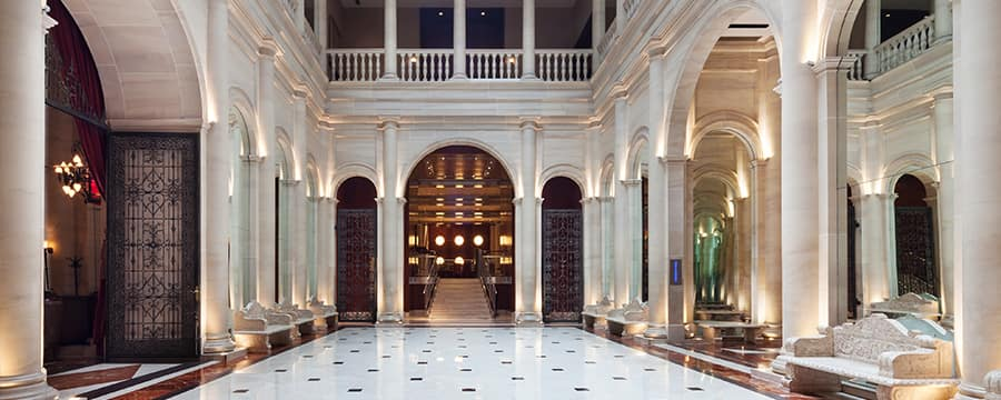 A hotel lobby with a marble floor and neoclassical columns at Le Parker Meridien New York