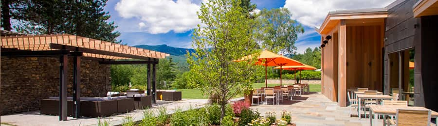An outdoor lounge and picnic area at Topnotch Resort and Spa in Stowe, Vermont