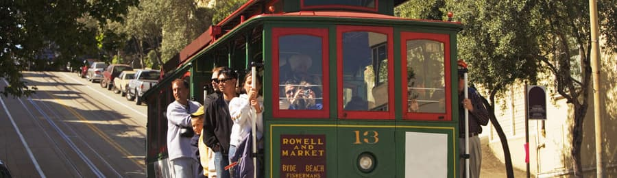 People riding on a cable car in San Francisco