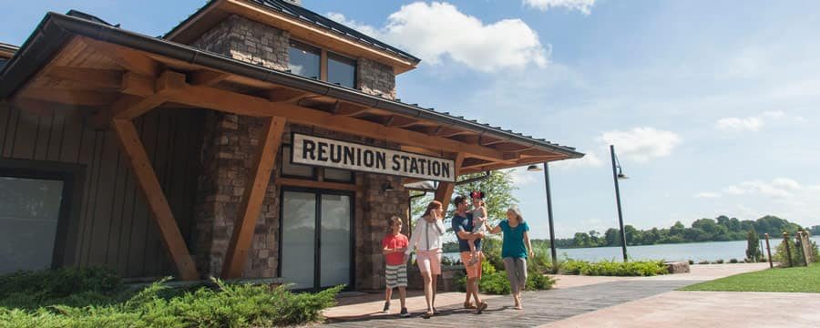 A family walking near the entrance to the Reunion Station building