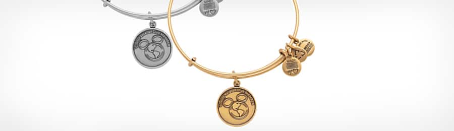 A gold ALEX AND ANI bangle bracelet with a Disney Vacation Club